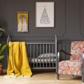 patterned-armchair-next-to-kids-bed-with-yellow-bl-N6F9MGS-scaled.jpg