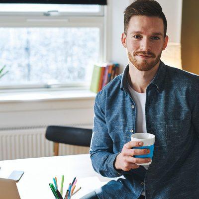 young-entrepreneur-sitting-in-his-office-F7Y2RBG.jpg